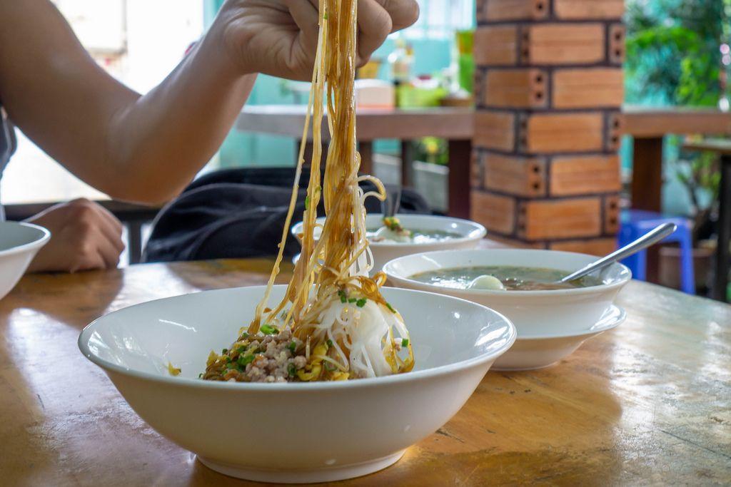 Eating Vietnamese Noodles with Pork in a Breakfast Restaurant in Saigon (Flip 2019) (Flip 2019) Flip 2019