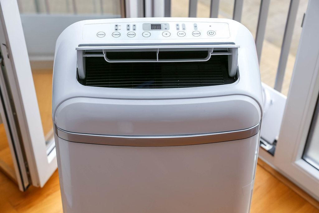 Eco-friendly and mobile air conditioner and dehumidifier with open ventilation, timer and sleepmodus by Comfee