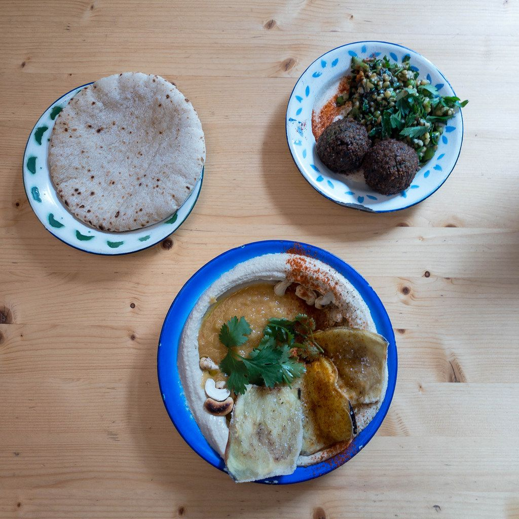 Eggplant with spicy mango tamarind, carrot cake with cashew-lemon frosting and flat bread
