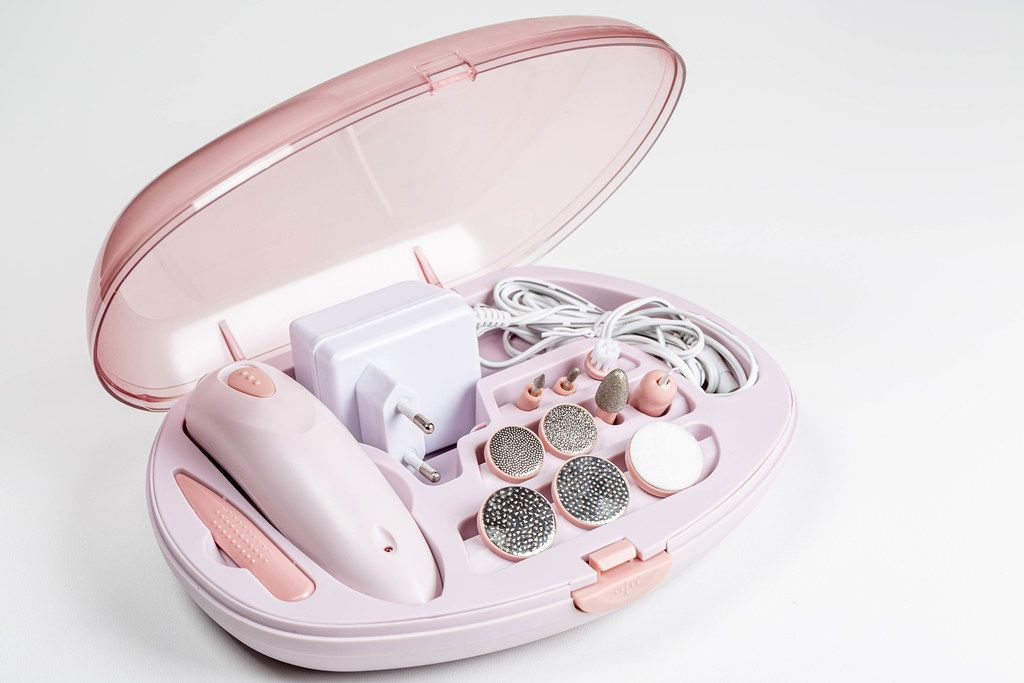 Electric professional nail manicure and pedicure machine on white