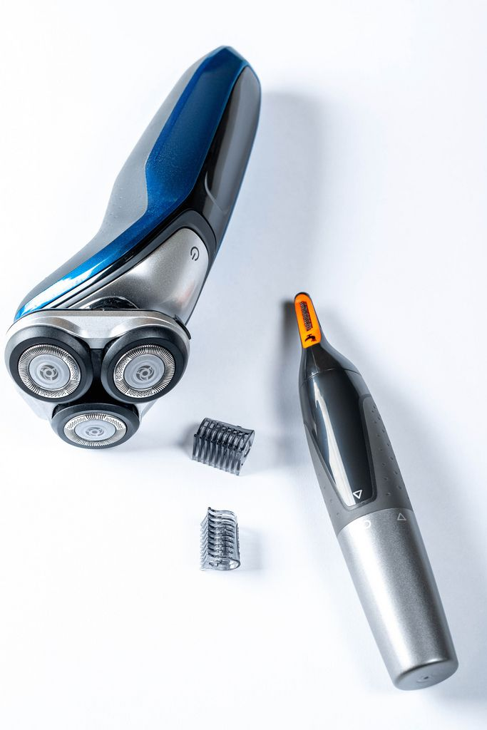 Electric shaver and trimmer for man on table