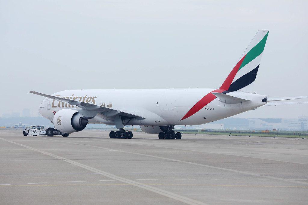 Emirates SkyCargo plane baing towed