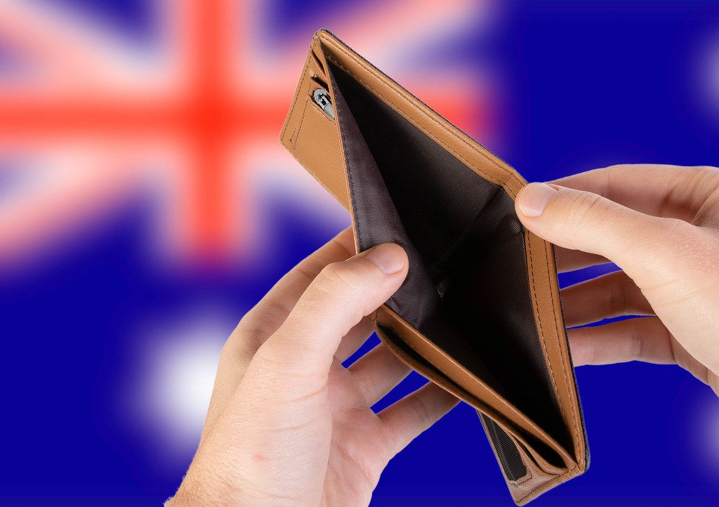 Empty Wallet with Flag of Australia. Recession and Financial Crisis to come with more debt and federal budget deficit?