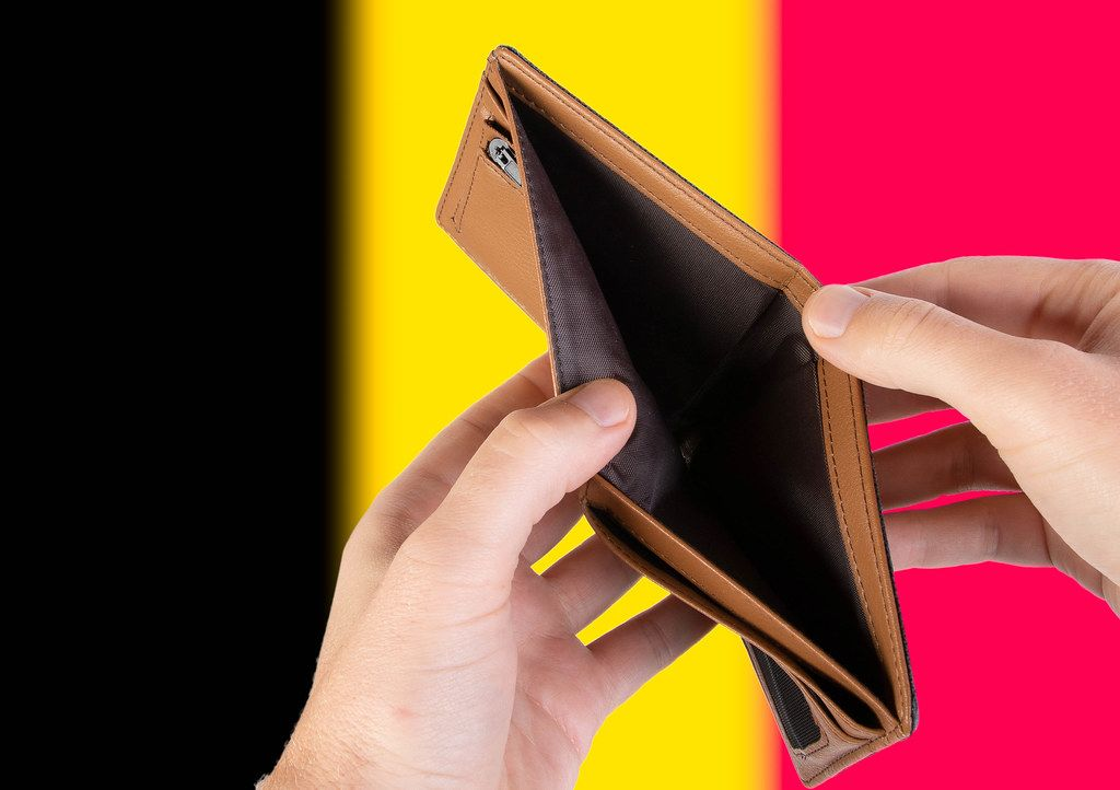 Empty Wallet with Flag of Belgium. Recession and Financial Crisis to come with more debt and federal budget deficit?
