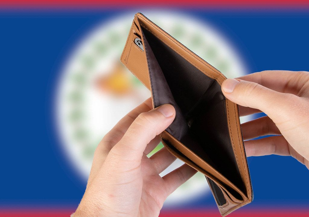 Empty Wallet with Flag of Belize. Recession and Financial Crisis to come with more debt and federal budget deficit?