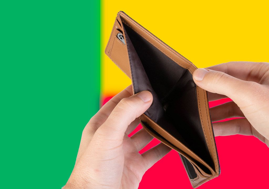 Empty Wallet with Flag of Benin. Recession and Financial Crisis to come with more debt and federal budget deficit?