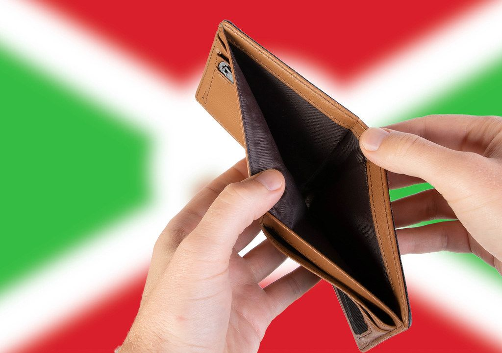 Empty Wallet with Flag of Burundi. Recession and Financial Crisis to come with more debt and federal budget deficit?