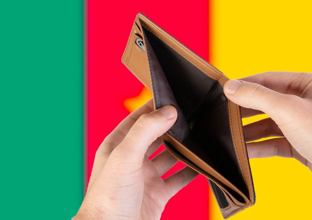 Empty Wallet with Flag of Cameroon. Recession and Financial Crisis to come with more debt and federal budget deficit?