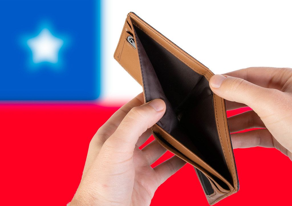 Empty Wallet with Flag of Chile. Recession and Financial Crisis to come with more debt and federal budget deficit?