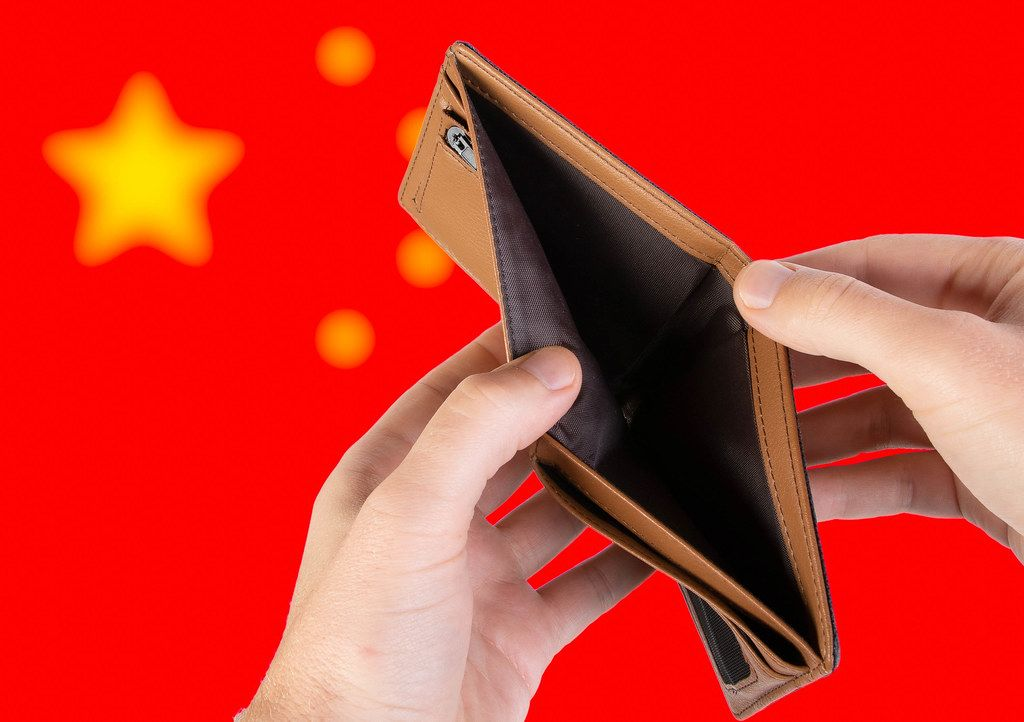 Empty Wallet with Flag of China. Recession and Financial Crisis to come with more debt and federal budget deficit?