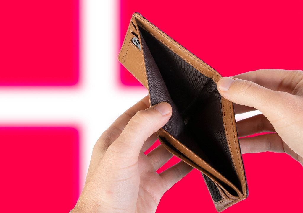 Empty Wallet with Flag of Denmark. Recession and Financial Crisis to come with more debt and federal budget deficit?
