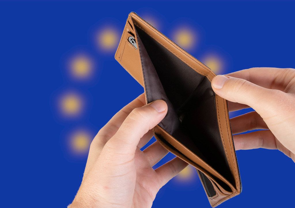Empty Wallet with Flag of European Union. Recession and Financial Crisis to come with more debt and federal budget deficit?
