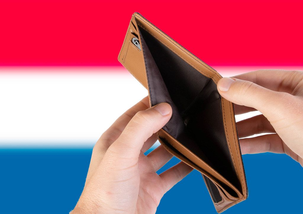 Empty Wallet with Flag of Netherlands. Recession and Financial Crisis to come with more debt and federal budget deficit?