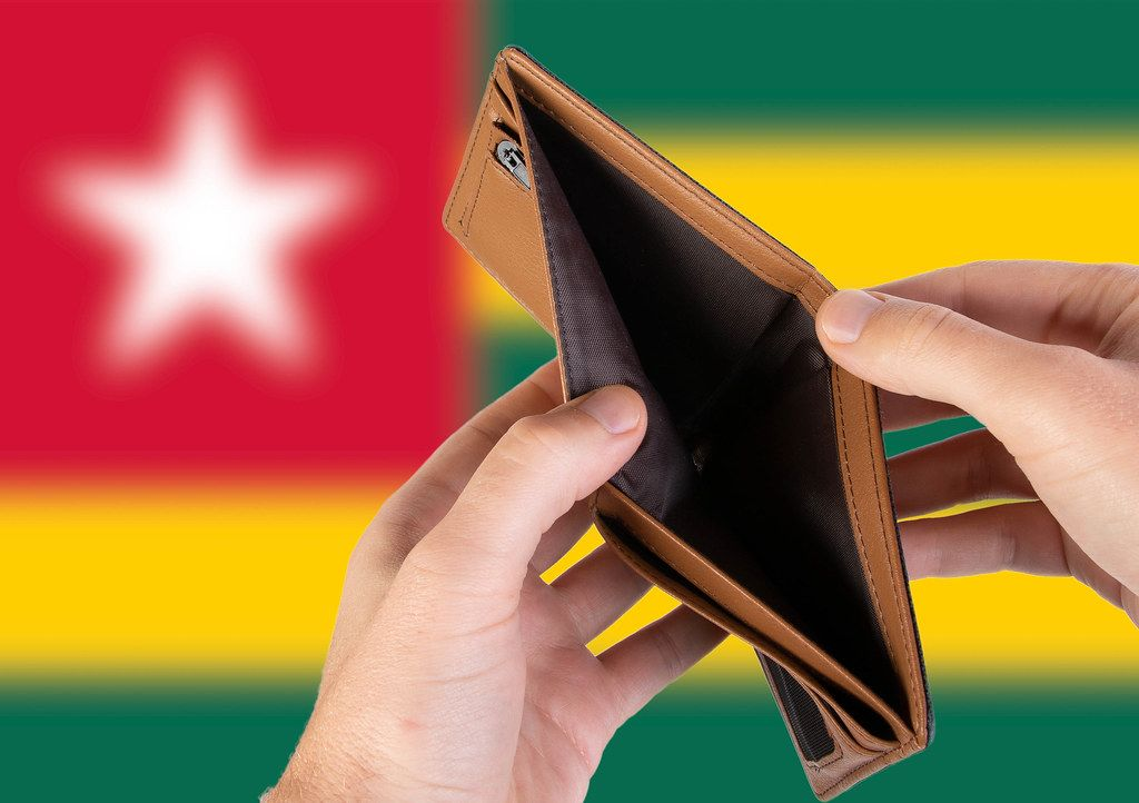 Empty Wallet with Flag of Togo. Recession and Financial Crisis to come with more debt and federal budget deficit?