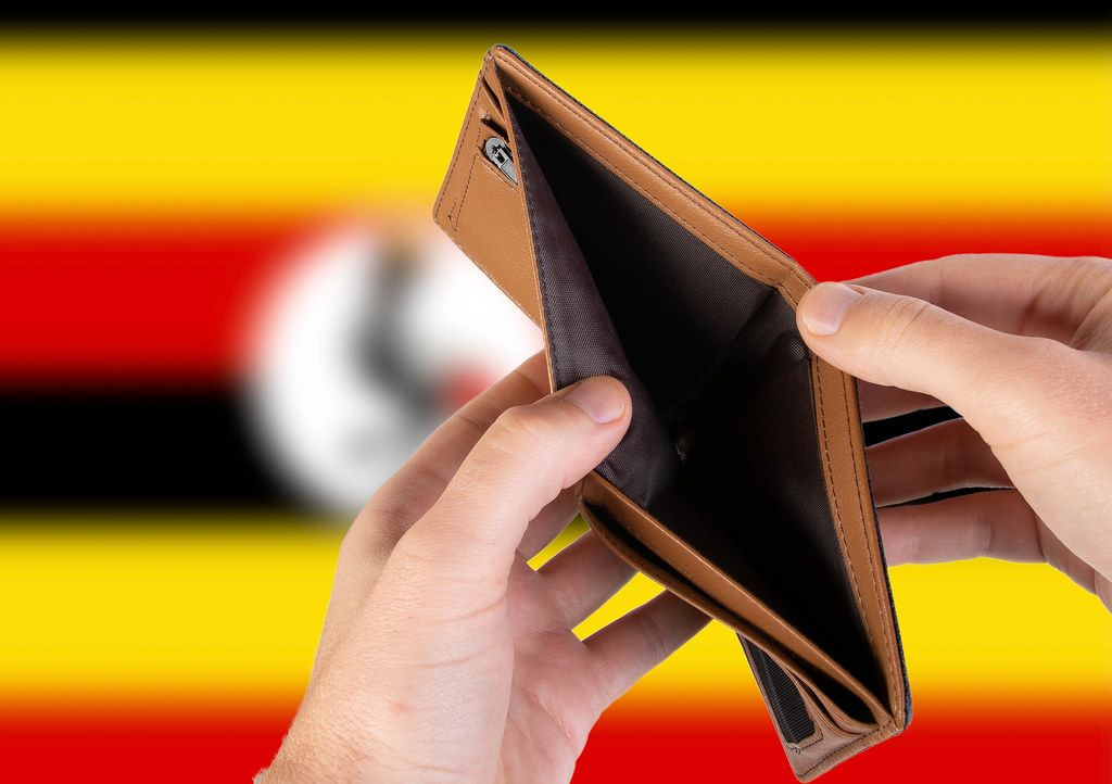 Empty Wallet with Flag of Uganda. Recession and Financial Crisis to come with more debt and federal budget deficit?