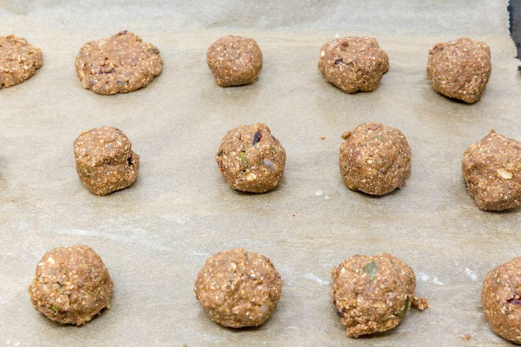 Energy Balls - Superfood Bakery - Glow Makers Cookies Dough Balls on baking paper
