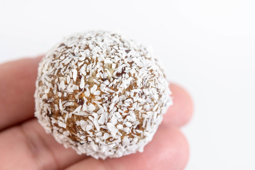 Energy Balls with Coconut on the hand