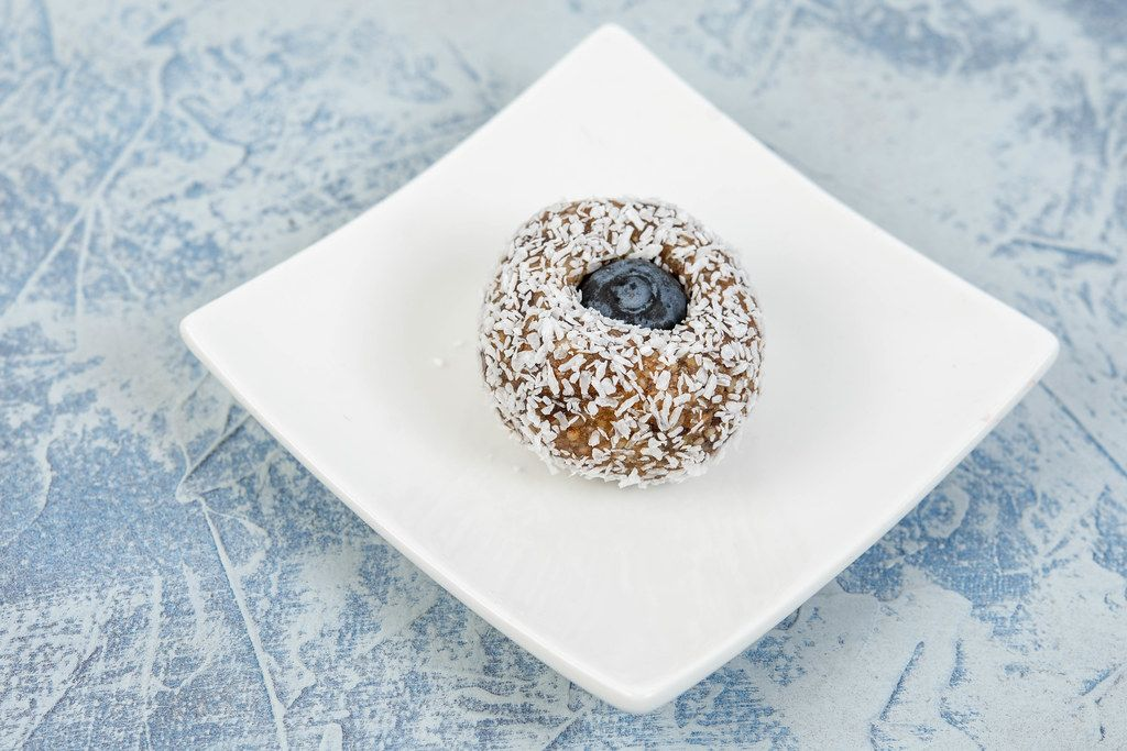 Energy Balls with Date Palm fruits Almonds Walnuts and Coconut and Blueberry