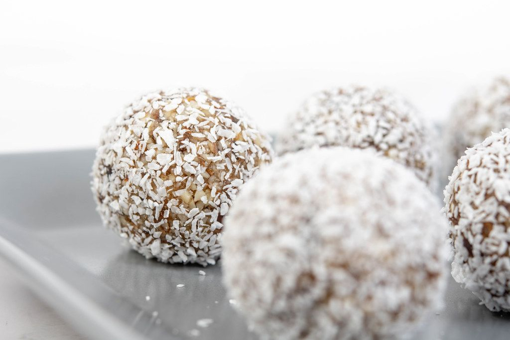 Energy Balls with Date Palm fruits Almonds Walnuts and Coconut on the plate