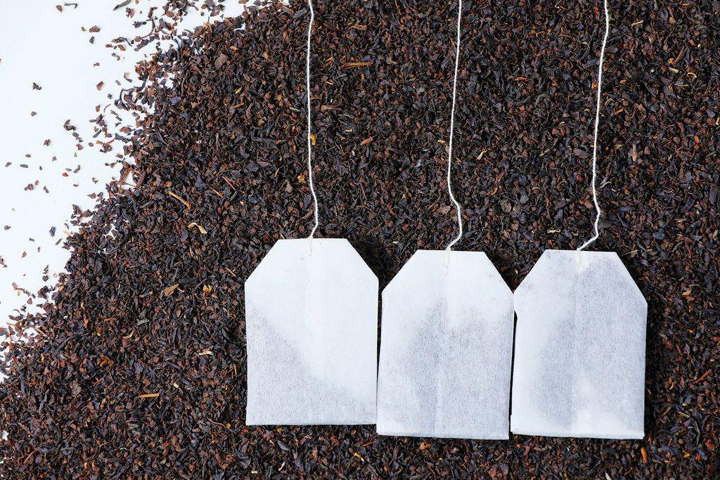 English Breakfast tea bags, dry tea background