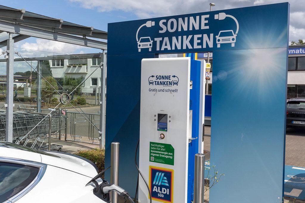 Environmental friendly gas station alternative: Tesla charges sun energy using type 2 plug, on an Aldi-Supermarket parking spot