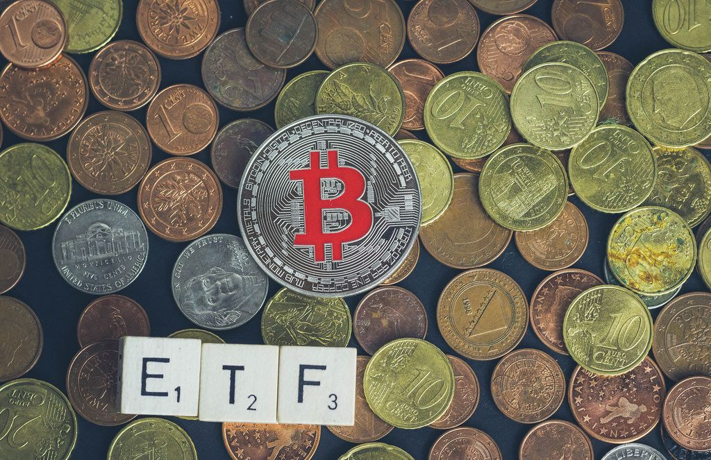 ETF text with silver Bitcoin
