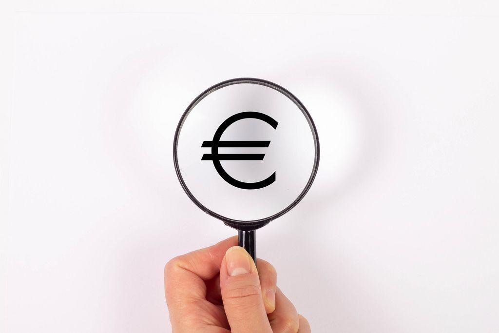 Euro symbol under magnifying glass