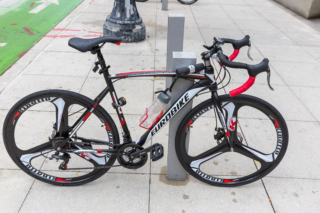 Eurobike speed road bicycle in black and white with red details parked in Downtown Chicago