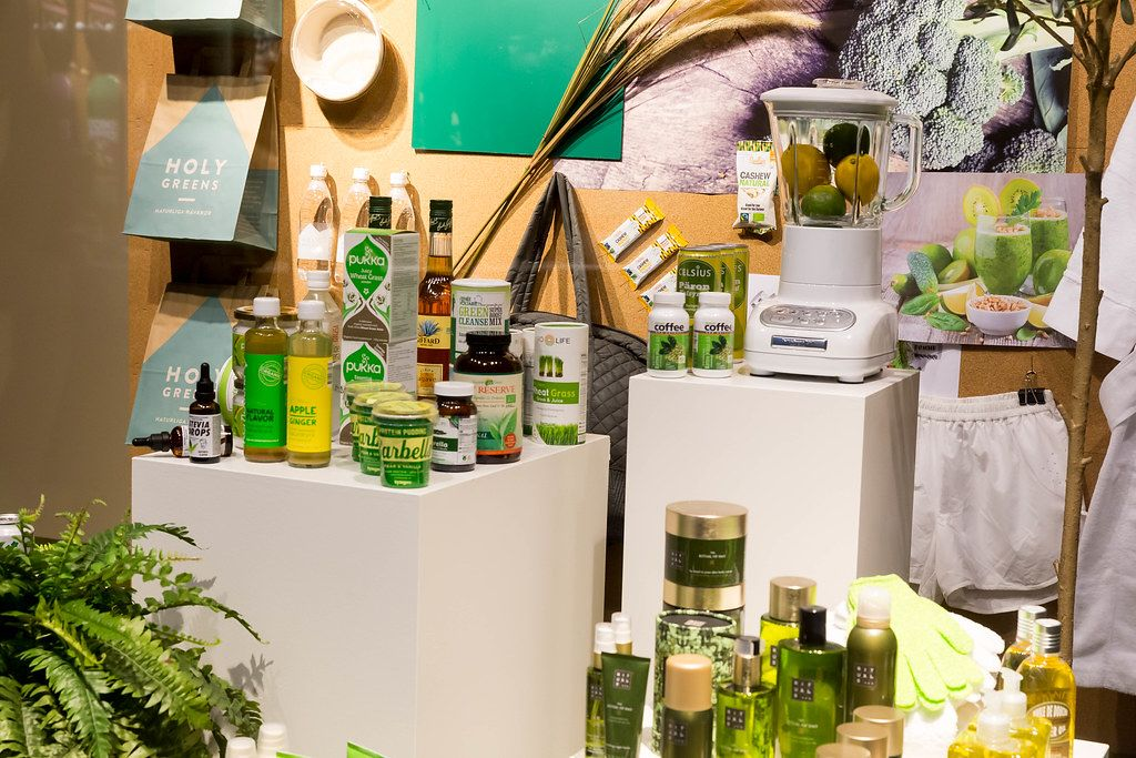 Fair display with healthy green supplements, care products and food