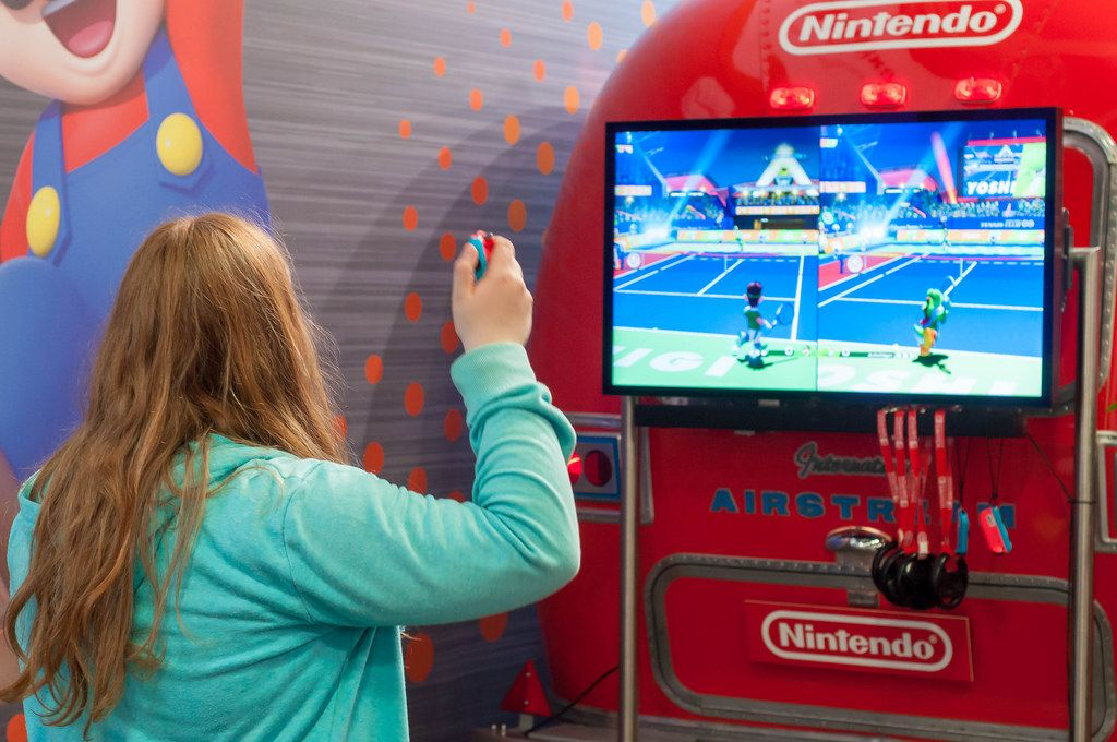Fair visitor playing Mario Tennis Aces for Nintendo Switch