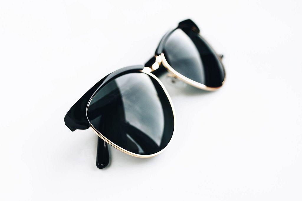 Fashionable sunglasses on white background.