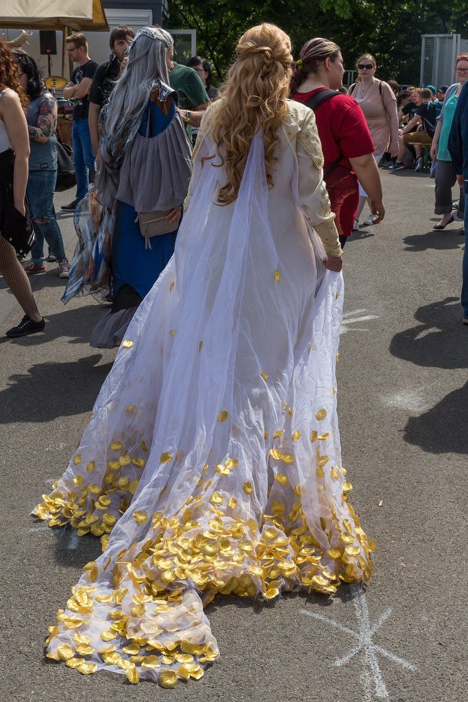 Female cosplayer in a long gown