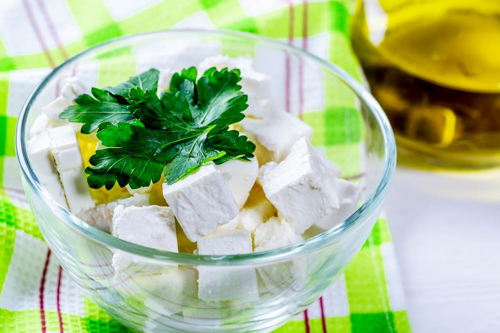 Feta cheese in a glass bowl