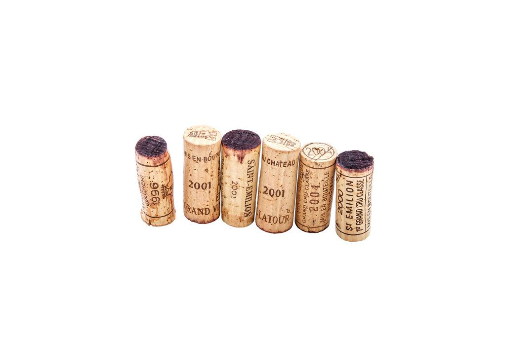 Few rare wine corks on white background