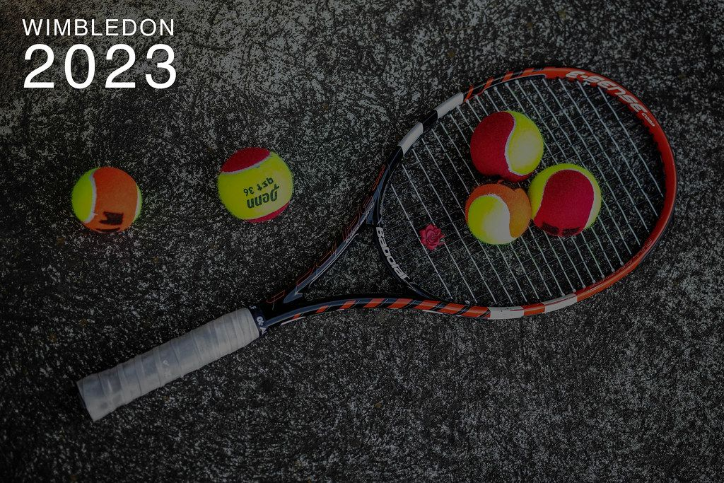 Five coloured tennis balls and a tennis racket on stone, next to the text