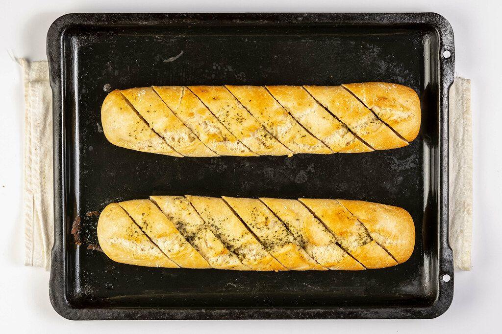 Flat lay above baked Bread Bruschetta on the baking tray (Flip 2019)