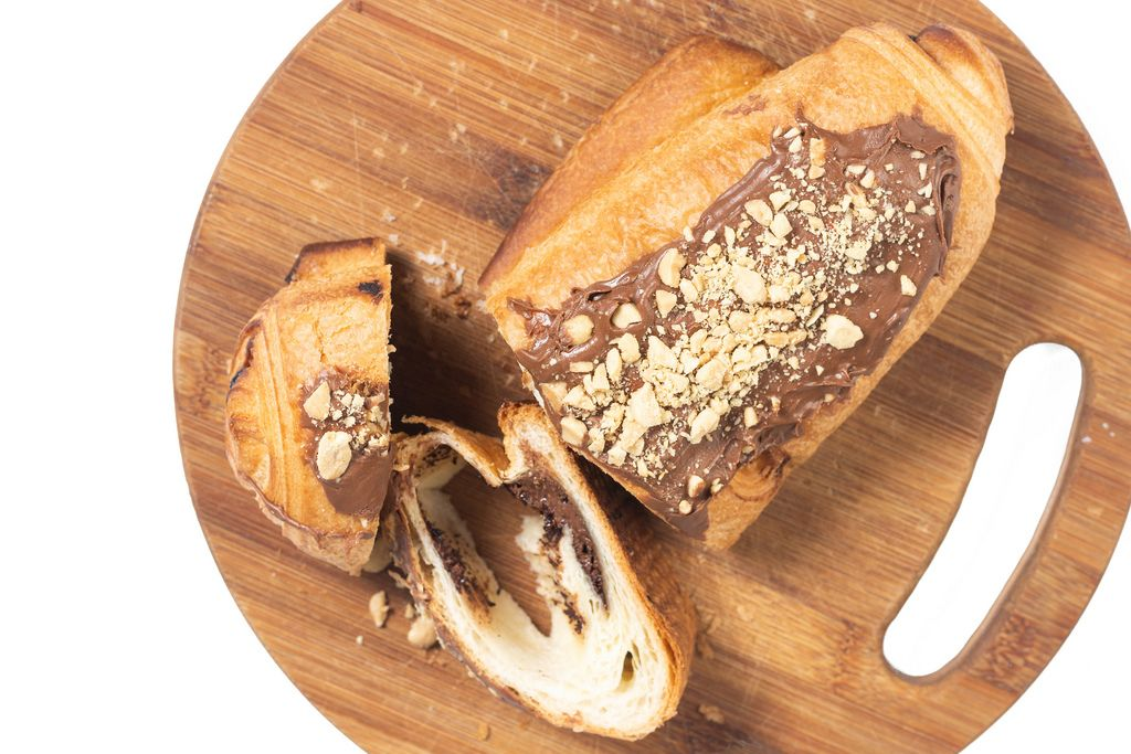 Flat lay above Bakery Pastry with Chocolate Cream and grated Hazelnuts