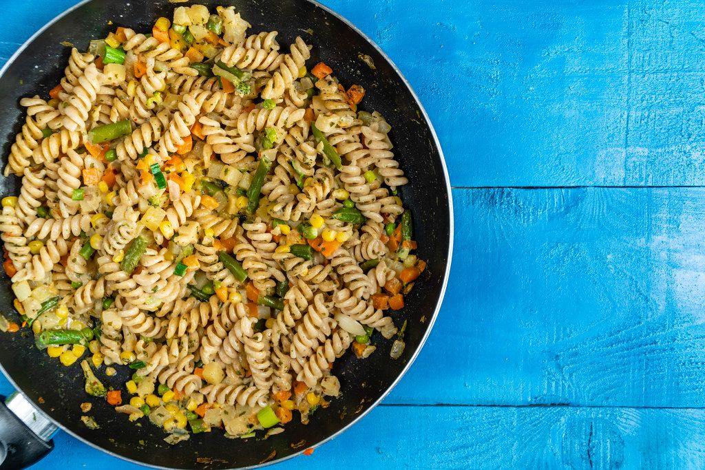 Flat lay above Cooked Vegetables with Pasta with Copy Space (Flip 2020)