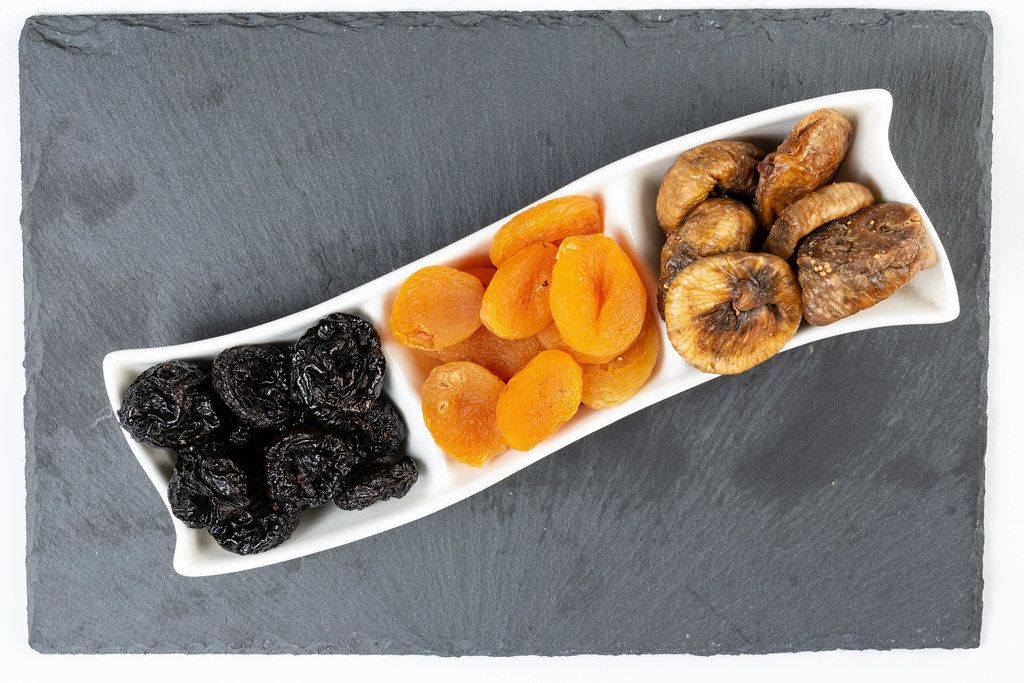 Flat lay above Dried Plums Peaches and Figs