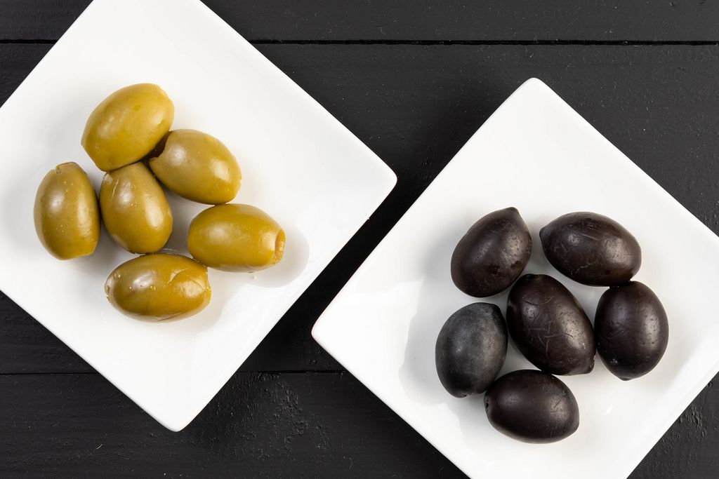 Flat lay above Green and Black Olives on the plate