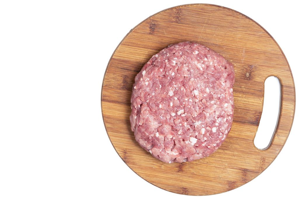 Flat lay above Minced Meat on the kitchen wooden board