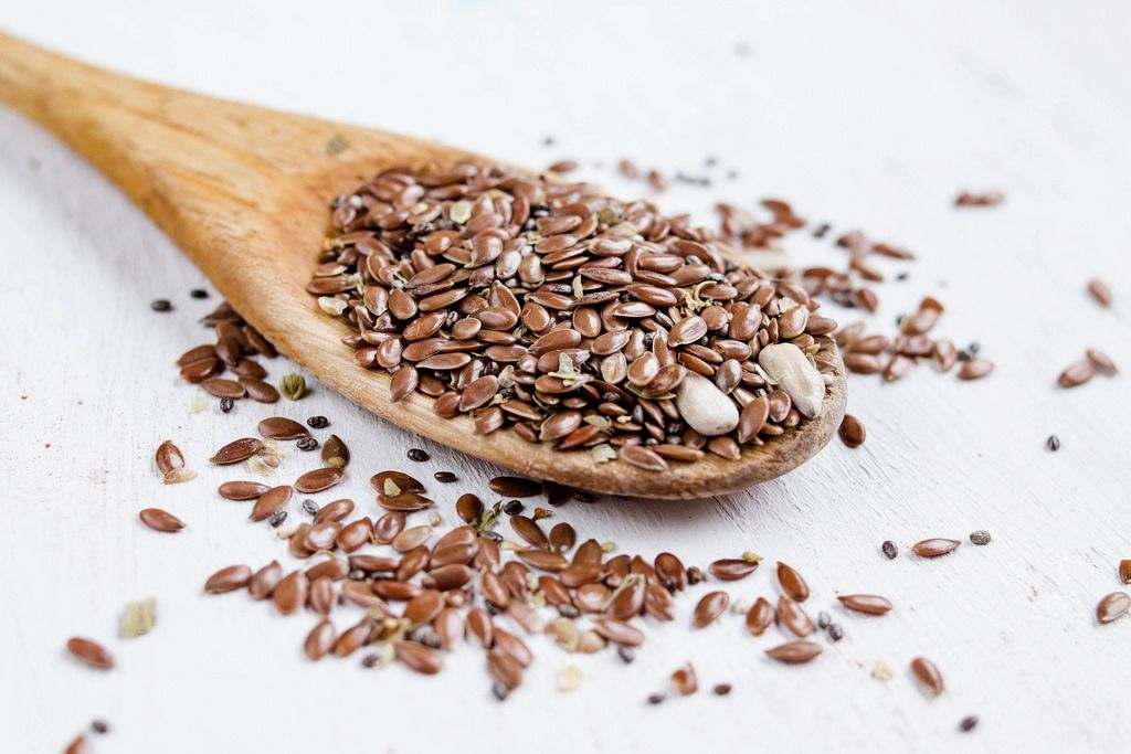 Flax seeds or linseed in wooden spoon