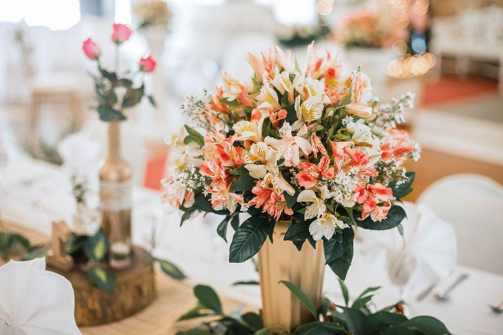 Flowers as center pieces at wedding table (Flip 2019) (Flip 2019) Flip 2019