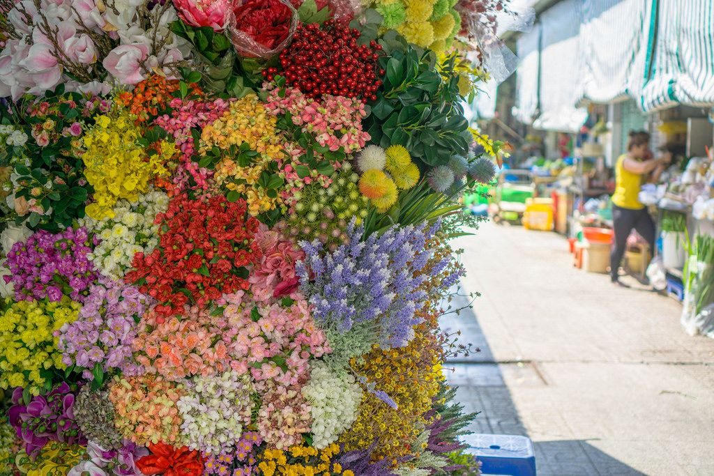 Flowers with Wet Market in the Background in Ho Chi Minh City
