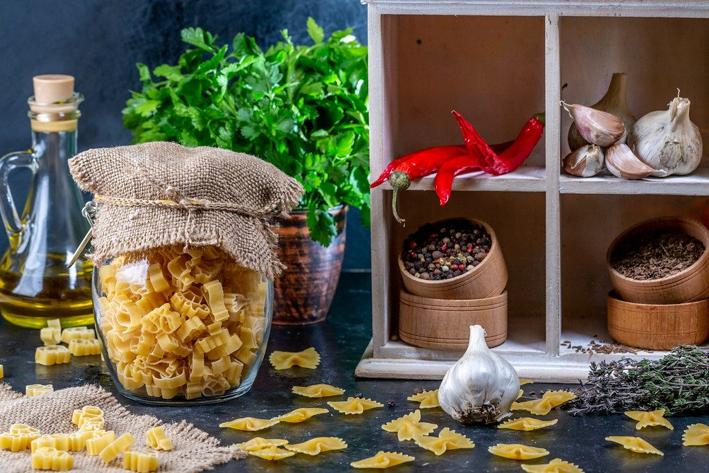 Food background with spices, herbs and pasta