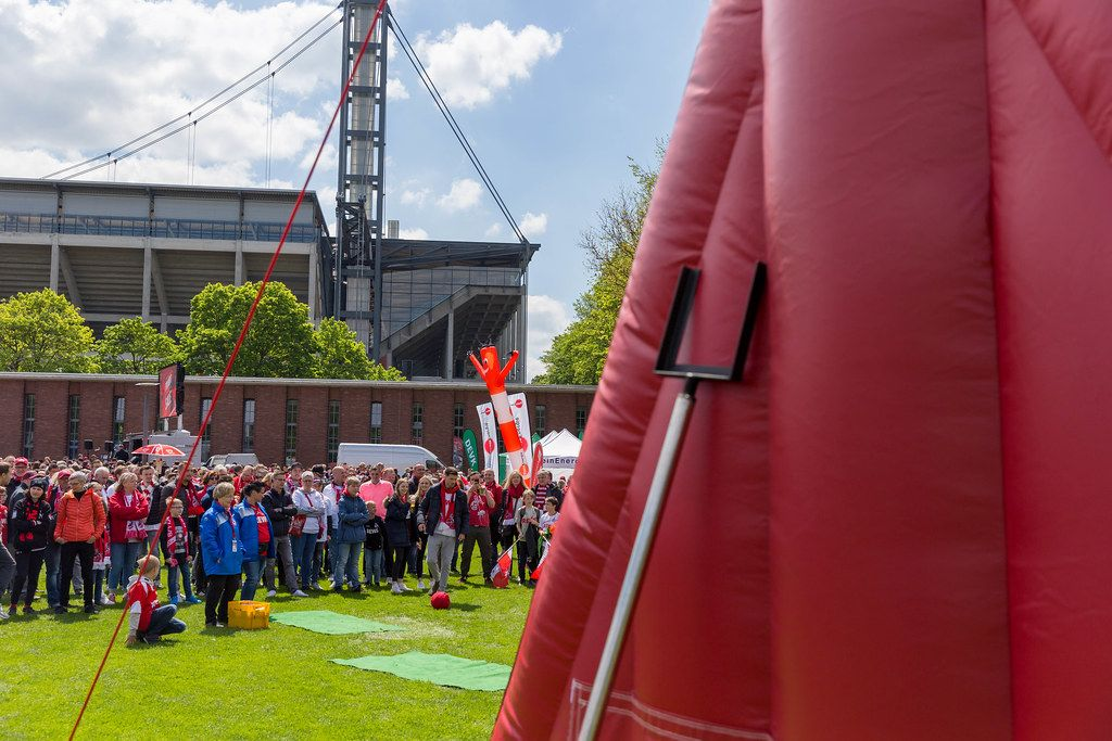 Football fans of the football team 1. FC Köln shoot footballs with Velcro at a gigantic target after the finals in front of Rhein Energie Stadium in Cologne