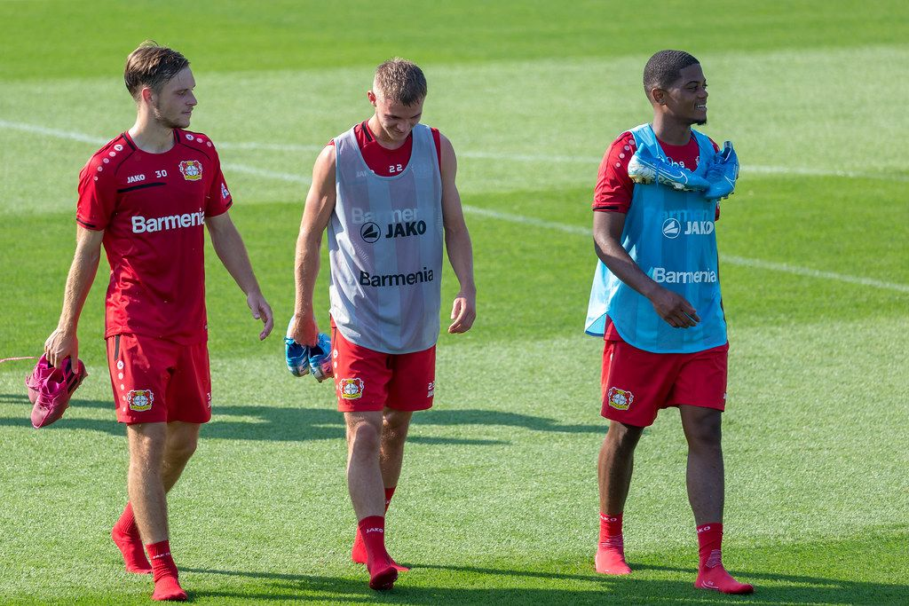 Football player Adrian Stanilewicz, Daley Sinkgraven and Leon Bailey walking barefoot over the football field in Germany, after practice