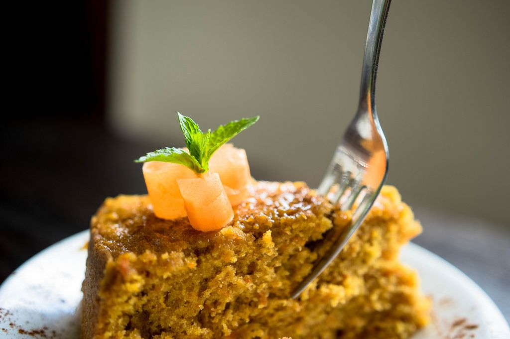 Fork inserted in a piece of carrot cake