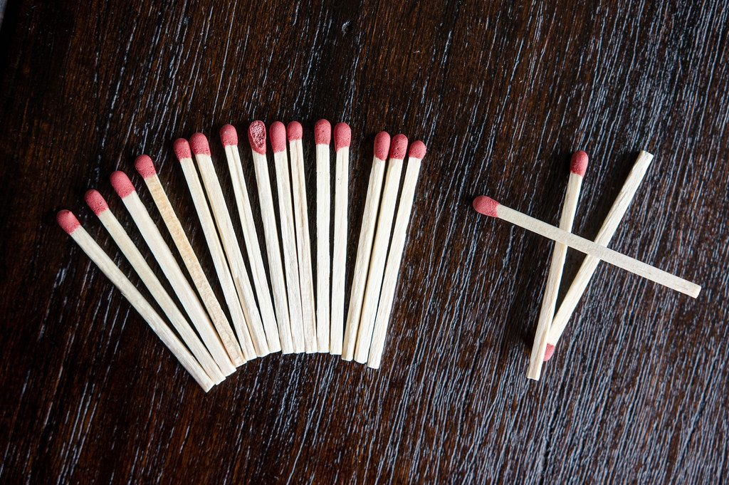 Formation of matches over wooden table