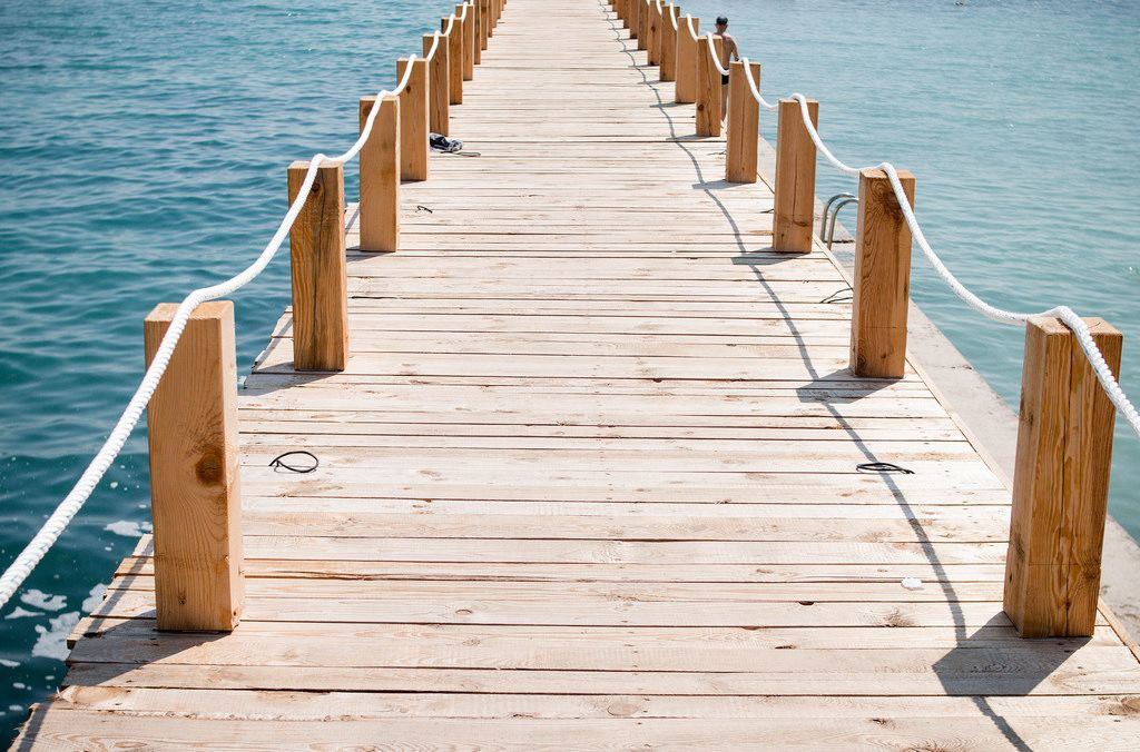 Freedom: Wooden bridge to the sea.
